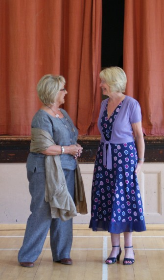 Singing students Heta Lumsden and Linda Taylor preparing to perform The Flower Duet